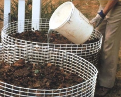 Adding water to compost